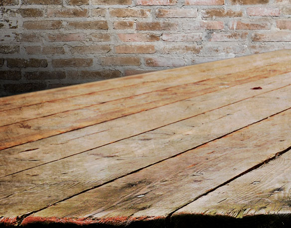 Three Aussie Farmers Wood Table and Brick Background