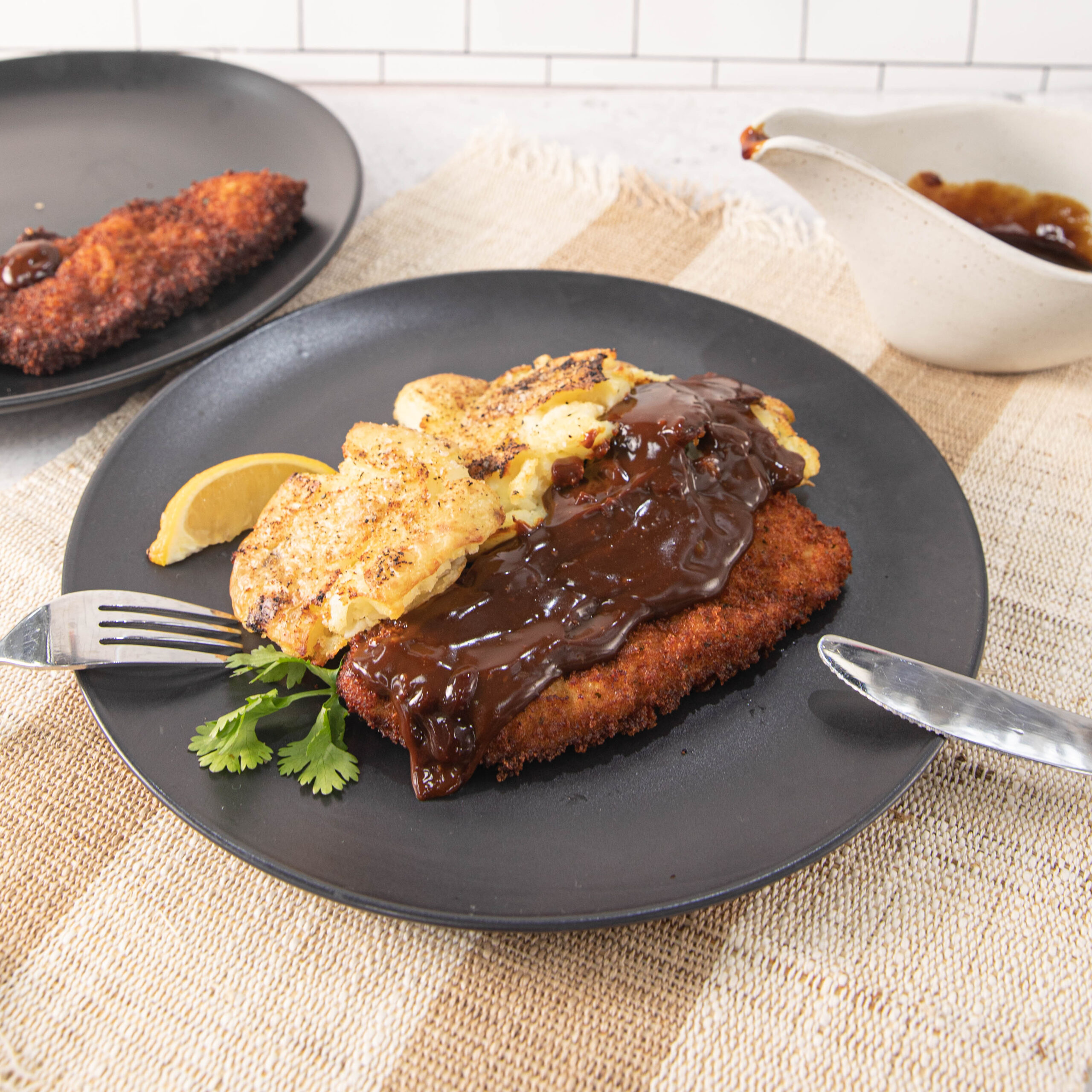 Three Aussie Farmers Schnitzels with Guinness Gravy and Crushed Potatoes